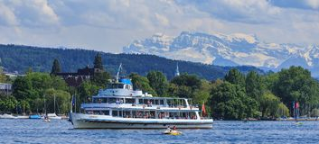 MS Limmat on Lake Zurich. Zurich, Switzerland - 26 May, 2016: MS Limmat passing on Lake Zurich with passengers on board, summits of the Alps in the background Stock Photography