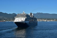 MS Nieuw Amsterdam. VANCOUVER, BC. AUGUST 26, 2017. Holland America Lines MS Nieuw Amsterdam sails from Canada Place past Stanley Park on a cruise to Alaska.n Stock Images