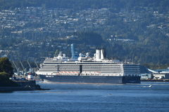 MS Nieuw Amsterdam. VANCOUVER, BC. AUGUST 26, 2017. Holland America Lines MS Nieuw Amsterdam sails from Canada Place past Stanley Park on a cruise to Alaska.n Royalty Free Stock Image