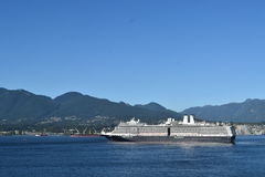 MS Nieuw Amsterdam. VANCOUVER, BC. AUGUST 26, 2017. Holland America Lines MS Nieuw Amsterdam sails from Canada Place past Stanley Park on a cruise to Alaska.n Royalty Free Stock Photo
