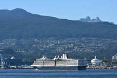 MS Nieuw Amsterdam. VANCOUVER, BC. AUGUST 26, 2017. Holland America Lines MS Nieuw Amsterdam sails from Canada Place past Stanley Park on a cruise to Alaska.n Royalty Free Stock Images