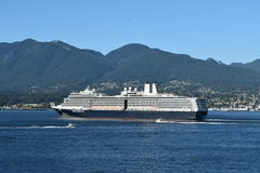 MS Nieuw Amsterdam. VANCOUVER, BC. AUGUST 26, 2017. Holland America Lines MS Nieuw Amsterdam sails from Canada Place past Stanley Park on a cruise to Alaska.n Stock Photos