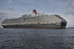 MS Queen Victoria. Southampton, United Kingdom - September 14, 2014: MS Queen Victoria, a cruise ship operated by the Cunard Line leaving the port of Southampton Royalty Free Stock Photos