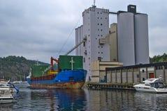 Ms vestvind. Is docked at the port of halden and fill grain from halden grain silo, vessel's details, ship type: cargo, year built: 1985, length x breadth: 81 Stock Image