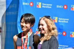 Ms. Yuko Mizuguchi won female 1st place at Vancouver marathon. Time is 02:41:28.0 stock images