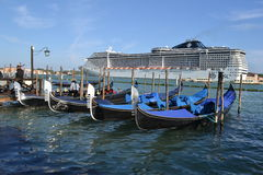 MSC cruise liner being drawn from Venice lagoon. Stock Image