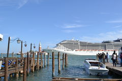 MSC cruise liner moving away from Venice lagoon. Stock Photos