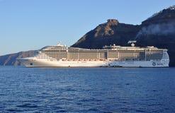 MSC Fantasia. Cruise ship near island of Santorini, Greece Royalty Free Stock Photos