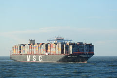 MSC Oscar Container Ship. Rotterdam, The Netherlands - March 3 2015: The MSC Oscar container ship enters the Port of Rotterdam for the first time. The largest Royalty Free Stock Photography