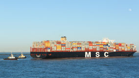 MSC Oscar at Port of Rotterdam. Rotterdam, The Netherlands - March 3 2015: The MSC Oscar container ship enters the Port of Rotterdam for the first time. The Royalty Free Stock Photography