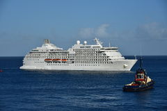 MSC Poesia Arriving Barbados observed by tug Royalty Free Stock Images