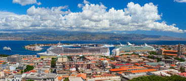 MSC `Splendida`, and `Voyager of the Seas` are docked in the port of Messina. Stock Images