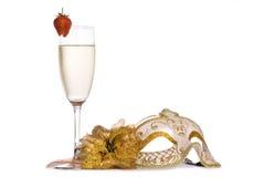 Máscara de la mascarada con champán Fotos de archivo libres de regalías