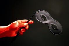 Máscara de teatro y guante rojo Imagen de archivo