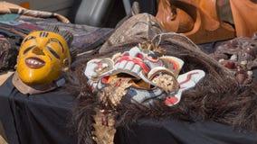 Máscaras antiguas en una venta de garaje Imágenes de archivo libres de regalías