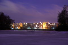 Mseno blocks of flats in Jablonec nad Nisou at night. Mseno blocks of flats seen across frozen city water reservoir Royalty Free Stock Image