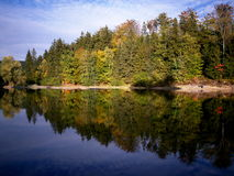 Mseno Reservoir in autumn, Jablonec nad Nisou. Autumn coloured trees mirrored in Mseno Reservoir in Jablonec nad Nisou Royalty Free Stock Images