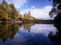 Mseno Reservoir, Jablonec nad Nisou. Autumn trees mirroring in Mseno Reservoir in Jablonec nad Nisou Stock Photos