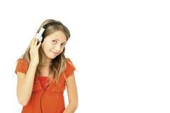 Música de escuta da menina Foto de Stock Royalty Free