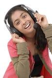 Música que escucha de la chica joven Foto de archivo libre de regalías