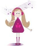 Música que escucha de la niña linda en auriculares Fotografía de archivo libre de regalías