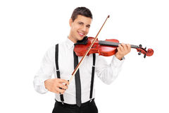Músico de sexo masculino alegre que toca un violín Imagen de archivo