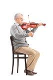 Músico mayor que toca un violín Imágenes de archivo libres de regalías