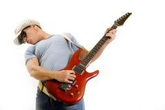 Músico que sostiene y que toca una guitarra eléctrica Fotos de archivo