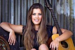 Músico Woman de la guitarra Imagen de archivo libre de regalías