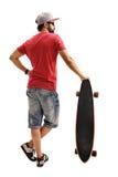 Męska łyżwiarka opiera na longboard Zdjęcie Stock