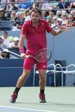 Mästare Stanislas Wawrinka för storslagen Slam av Schweiz i handling under hans runda match fyra på US Open 2016 Arkivbilder