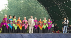 Mstera,Russia-August 8,2015:Chorus of the womans sings on open scene. Chorus of the elderly womans with bright kerchief sing on scene at day of the city Mstera Royalty Free Stock Image