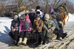 Mstera,Russia-February 21,2015: Children ride on sled with horse at day of the Shrovetide Stock Image