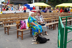 Mstyora,Russia-August 16,2014: Elderly women(woman)s talk sittin. Mstyora,Russia-August 16,2014: Elderly women(woman)s talk on bench at day of the city Royalty Free Stock Image