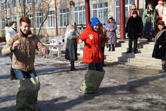 Mstyora,Russia-February 28,2014:Contest on spring holiday of the Shrovetide. Mstyora,Russia-February 28,2014:Young people jump in bag take part in contest on Stock Image