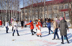 Mstyora,Russia-February 28,2014: Traditional celebration of the Shrovetide in Russia. Mstyora,Russia-February 28,2014: Young people draw colour water on snow at Stock Photography