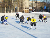 Mstyora,Russia-January 28,2012: Atheletic game of hockey on icy platform. Mstyora,Russia-January 28,2012: Command atheletic game of hockey on open platform under Royalty Free Stock Image