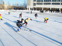 Mstyora,Russia-January 28,2012: Atheletic game of hockey on icy platform. Mstyora,Russia-January 28,2012: Atheletic game of hockey on open icy platform between Royalty Free Stock Photos