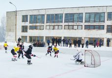 Mstyora,Russia-January 12,2013: Icy hockey on open platform in winter. Mstyora,Russia-January 12,2013: Icy hockey between command in winter on open platform in Royalty Free Stock Images