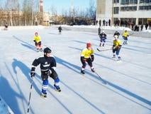 Mstyora,Russia-January 28,2012: Icy hockey on open platform in winter. Mstyora,Russia-January 28,2012: Icy hockey between male command in winter on open platform Royalty Free Stock Photos