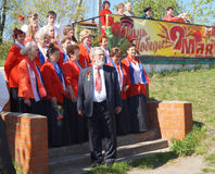 Mstyora,Russia-May 9,2014: Group of the womans in red woman's ja. Mstyora,Russia-May 9,2014: Group of the elderly womans in red woman's jacket cost(stand) on Royalty Free Stock Photos