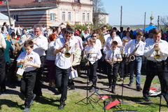 Mstyora,Russia-May 9,2014: People with music instrument go on ce. Mstyora,Russia-May 9,2014: Musicians with music instrument go to place of the celebration of Royalty Free Stock Photography