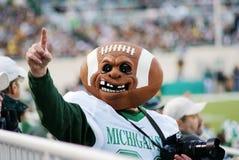 MSU contra Michigan, fanático del fútbol Fotografía de archivo libre de regalías