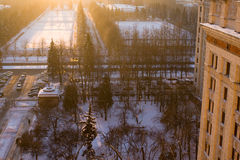 MSU morning. View from the window of Moscow State University dormitory in winter: snow, trees, part of the building. Sunrise Royalty Free Stock Photography