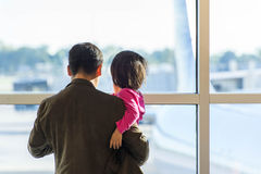 MSY, man and child looking out window at airplane Stock Photos