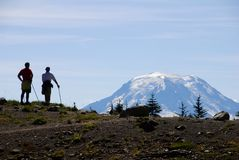Mt. Adams, hikers. Two hikers looking at Mt. Adams, seen from Goat Rocks Wilderness Royalty Free Stock Photo