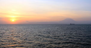 Mt. Agung and ship. Sunset, with Mt. agung as background and ship Stock Photo