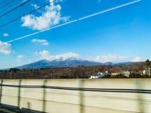 Mt. Asama from Shinkansen. In Japan Stock Photos