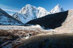 Mt Cholatse, Tabuche peak and Arakam Tse. Beautiful mountains on the way to Everest base camp - Mt Cholatse, Tabuche peak and Arakam Tse - Nepal Royalty Free Stock Photo