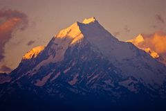 Mt. Cook closeup in orange sunrise time, New Zealand. Touristic attraction of New Zealand, Australasia travelling, majestic mountain stock images